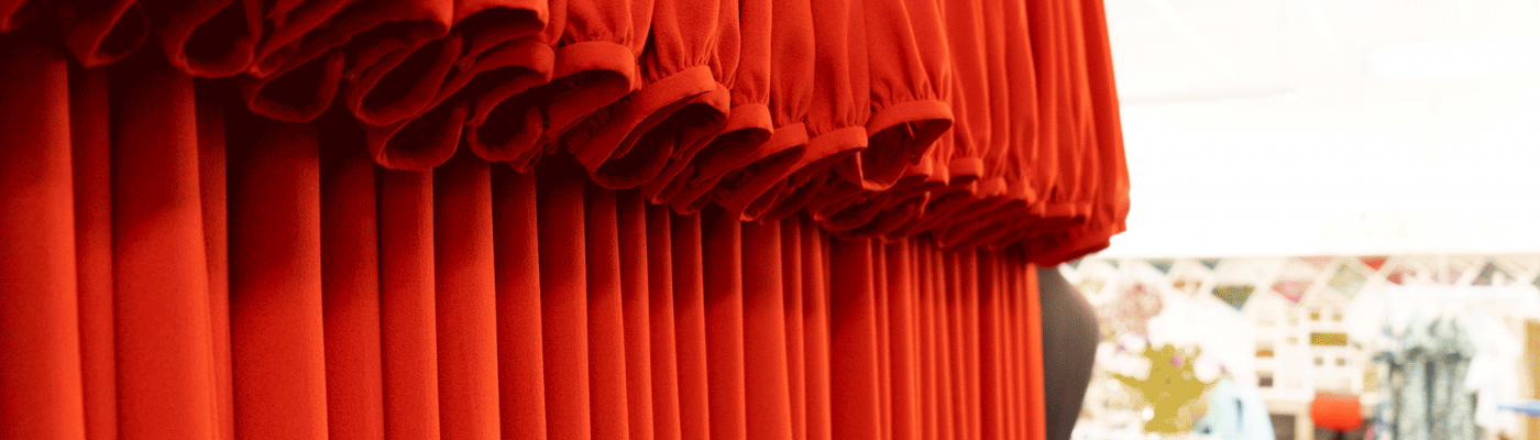 Red Dresses On a Rail